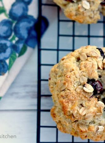 A round oatmeal scone with blueberries.