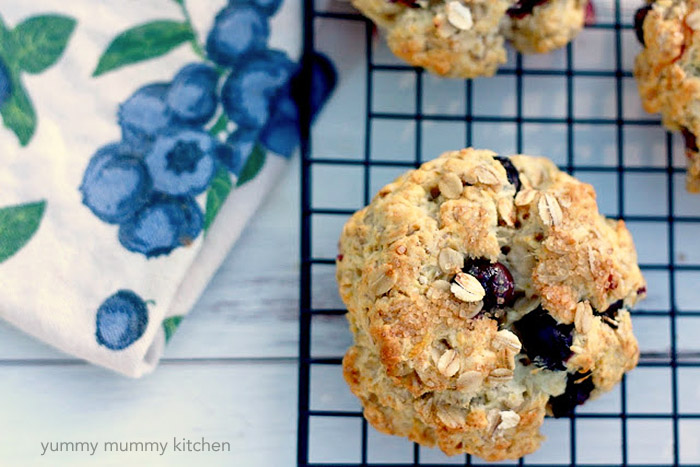 Hearty oat scones studded with juicy blueberries make any brunch or tea time feel special.