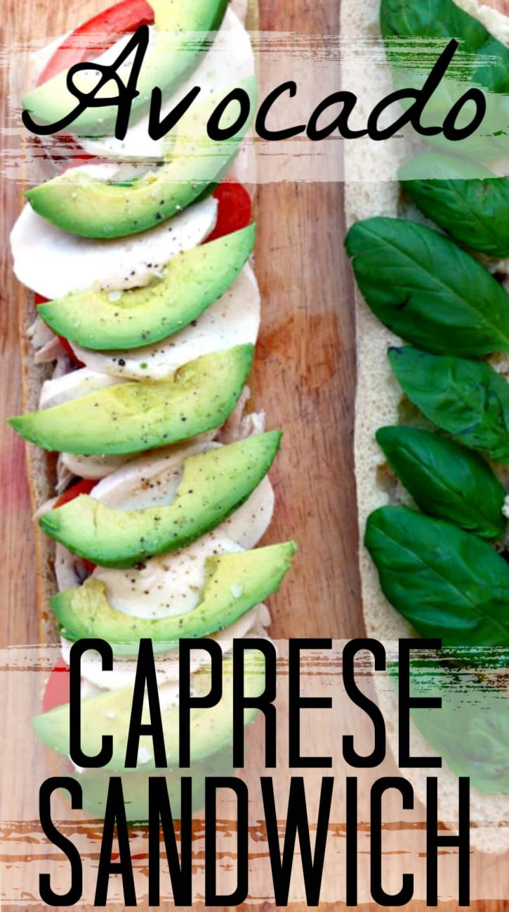 Baguette topped with tomato, fresh mozzarella, avocado, and basil for a Caprese sandwich.
