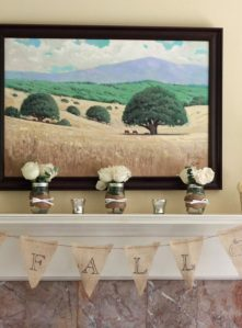 A DIY fall burlap and twine mantel.
