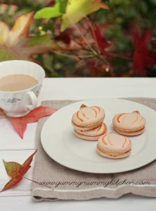 Pumpkin shaped pumpkin French macaron cookies are perfect for Thanksgiving or fall.