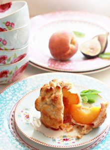 Beautiful whole peach wrapped in pastry crust.