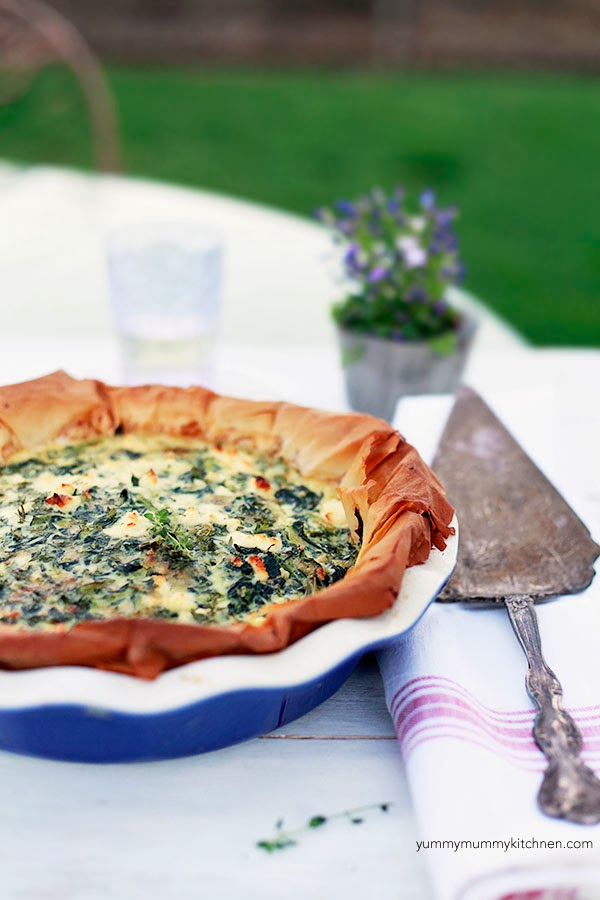 Filled with spinach and feta, this Greek inspired quiche has all the flavors of spanakopita.