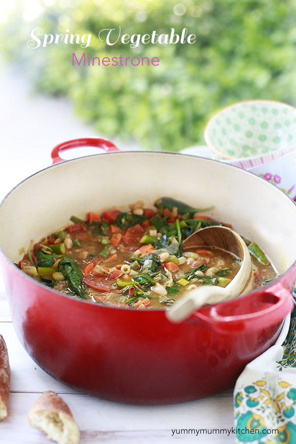 This delicious minestrone soup recipe is a family favorite! It's loaded with spring vegetables like carrots, asparagus, and spinach and gets extra flavor from pesto. Minestrone with white beans and vegetables is a great healthy, vegetarian, one pot soup.