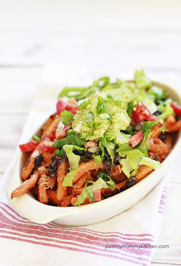 Easy sweet potato fries loaded with black beans, cheese, lettuce, tomatoes and guacamole!