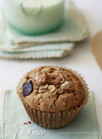 Peanut butter oatmeal muffin with chia seeds and chocolate chunks.
