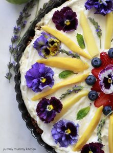 Beautiful breakfast tart with yogurt, fruit, and edible flowers.