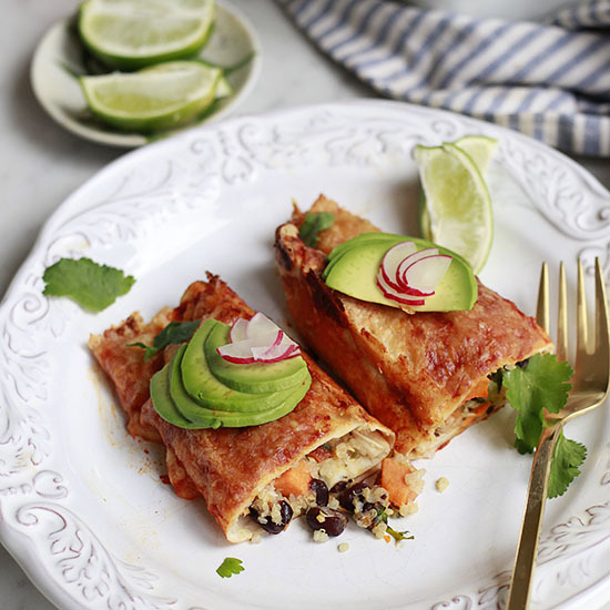 Wholesome enchiladas filled with quinoa, black beans, and sweet potatoes are an easy and tasty vegetarian dinner.