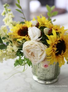 A beautiful DIY flower arrangement with sunflowers and garden roses.