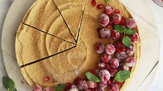 Vegan Pumpkin Cheesecake Topped with Cranberries
