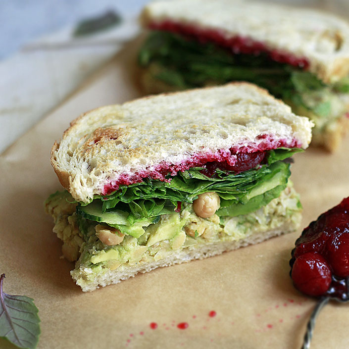 This vegetarian and vegan smashed chickpea and avocado sandwich has a delicious Thanksgiving flare thanks to the addition of cranberry sauce! Make just one sandwich and store the chickpea salad in the refrigerator, or make up to 3.