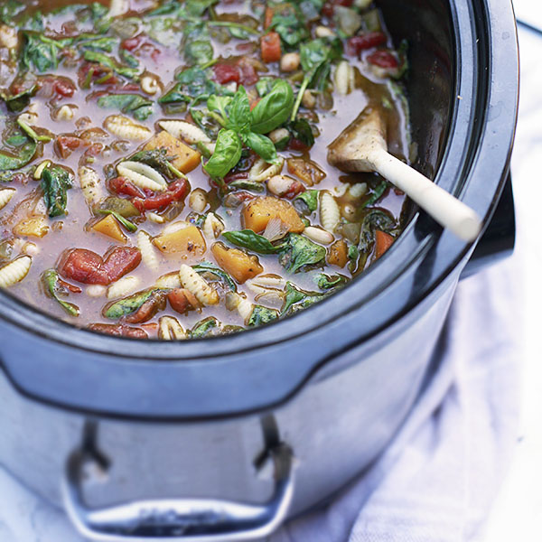 This wholesome minestrone loaded with vegetables is an easy one-pot meal. Slow cooker minestrone soup is an easy vegetarian dinner with vegan and gluten free options.
