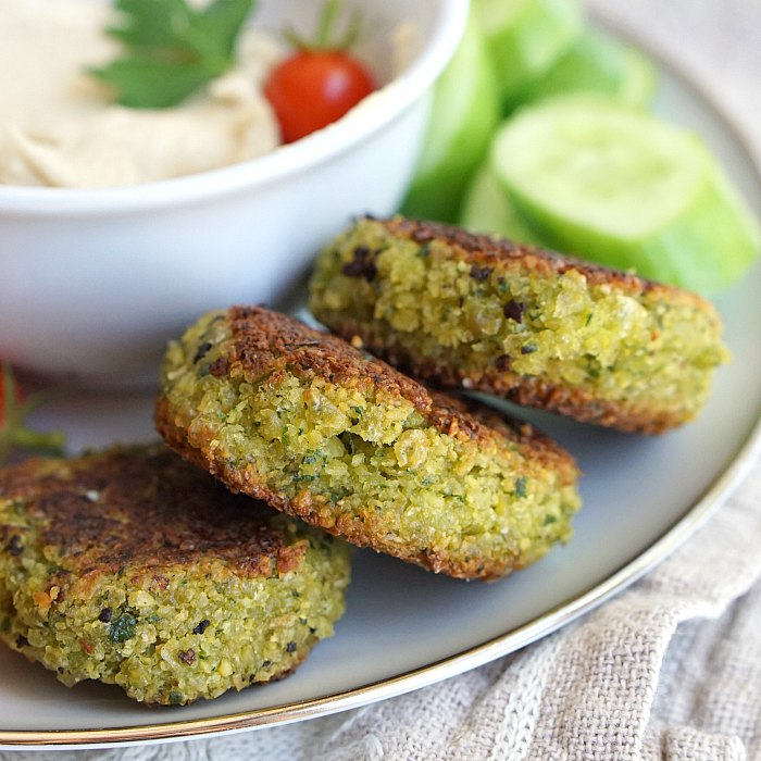 This falafel recipe doesn't require any deep frying. The dough comes together quickly in the food processor and falafel are browned in a pan before being baked. These falafel are naturally vegan and gluten free. This makes a large batch so that you have enough to freeze for later. If you just want enough to serve a family of 4, halve this recipe!