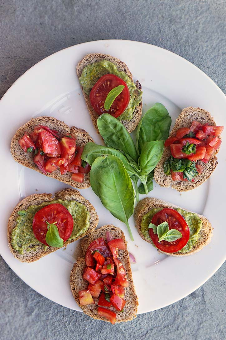A plateful of classic tomato and pesto bruschetta is an easy appetizer.