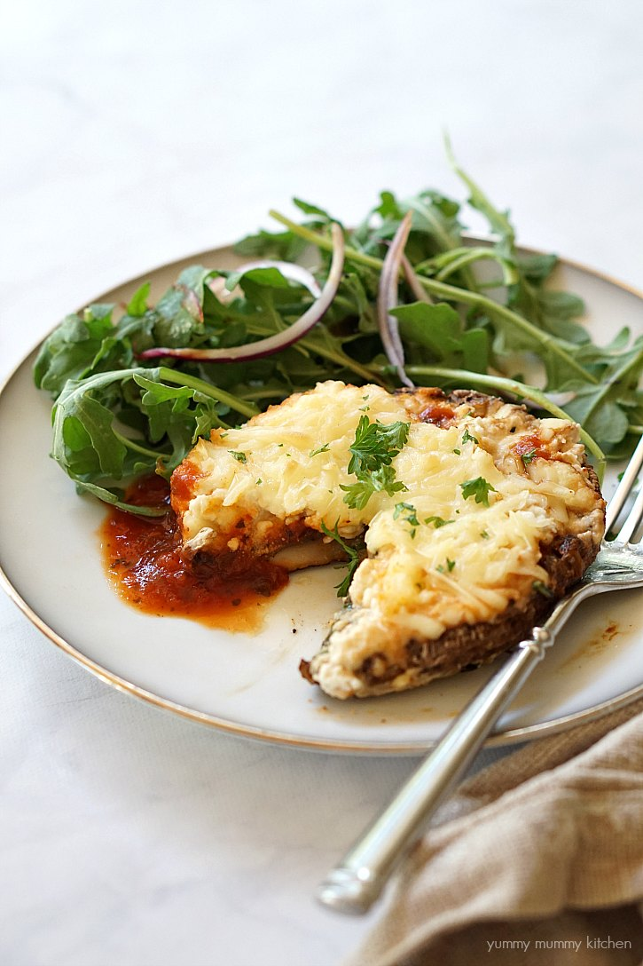 Vegan lasagna stuffed portobello mushroom made with almond ricotta.