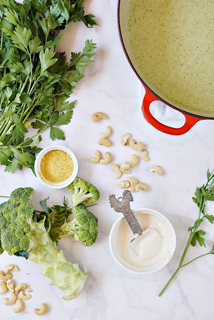 The simple ingredients for this vegan cream of broccoli soup include cashews, nutritional yeast, parsley, garlic, and broccoli.