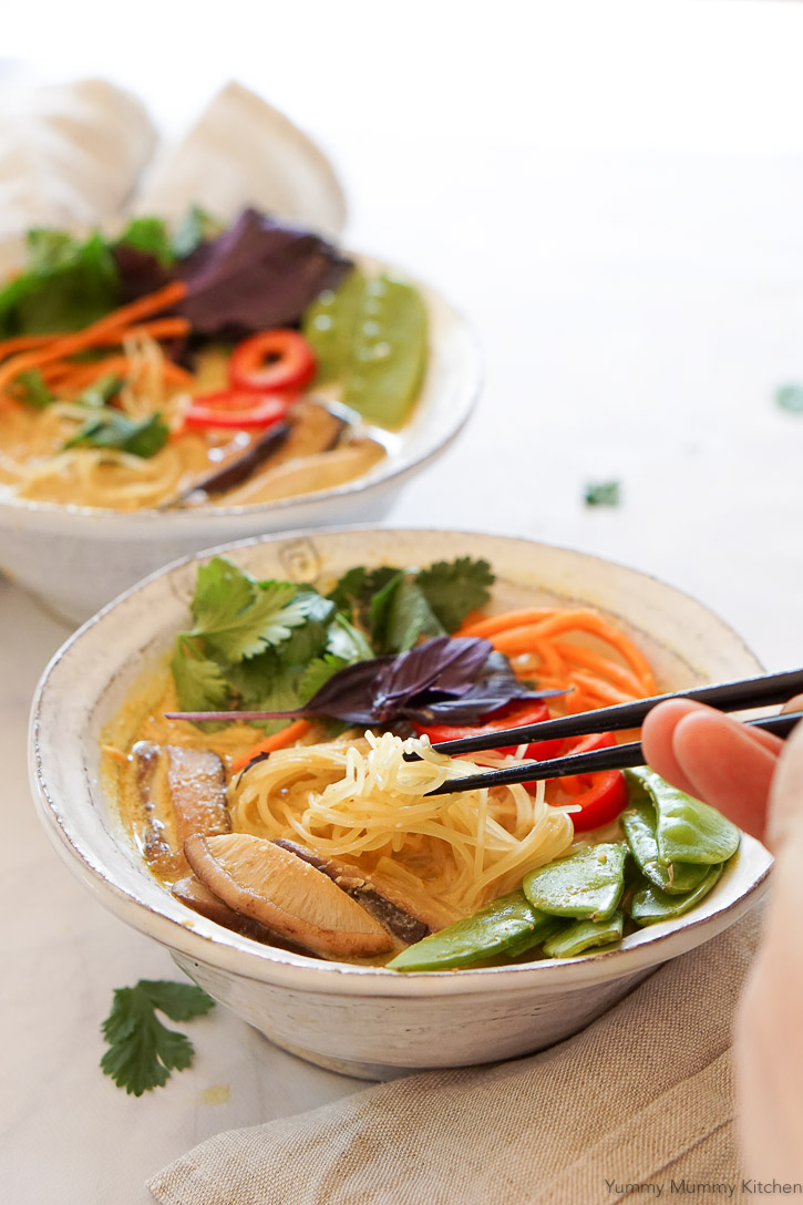 Beautiful vegan Thai coconut curry soup with rice noodles and veggies. This colorful bowl makes an easy and healthy dinner.