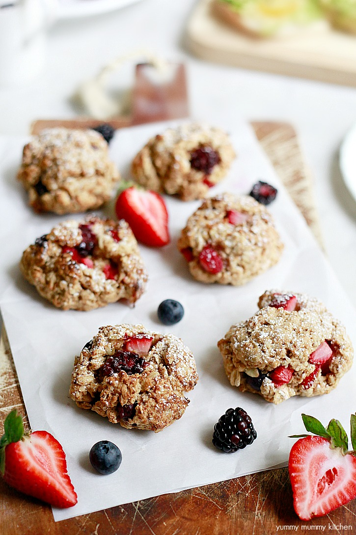 Beautiful vegan oatmeal scones with berries and powdered sugar for brunch.
