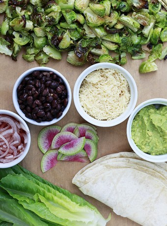 Roasted Brussels sprouts and toppings to make Brussels sprouts tacos.