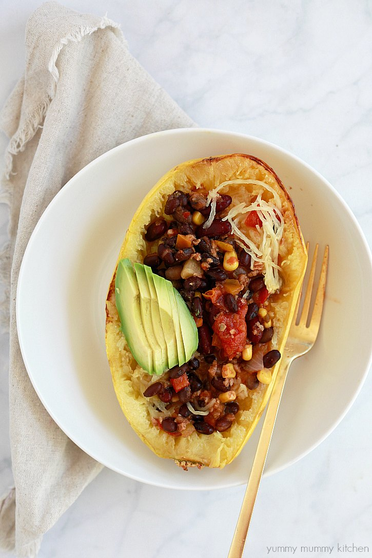 Roasted spaghetti squash boats with chili and avocado make a delicious vegan meal.