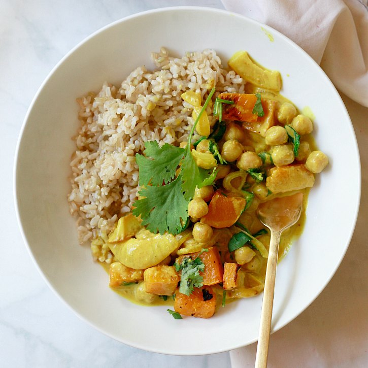 An easy curry with yellow curry paste, chickpeas, vegetables, and coconut milk. This nourishing vegan meal is sure to become a regular on your dinner rotation.
