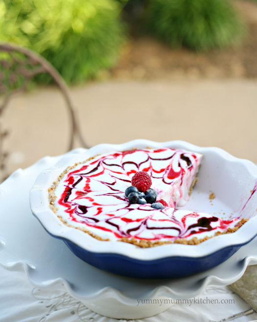 Ice cream pie with berry sauces swirled together and a granola crust. This red, white, and blue ice cream pie is perfect for Memorial Day, Fourth of July, or summer.
