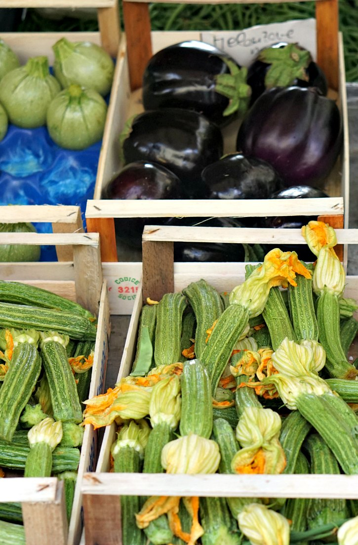 Beautiful zucchini and eggplant at the farmers market in Greve in Chianti, Tuscany, Italy.