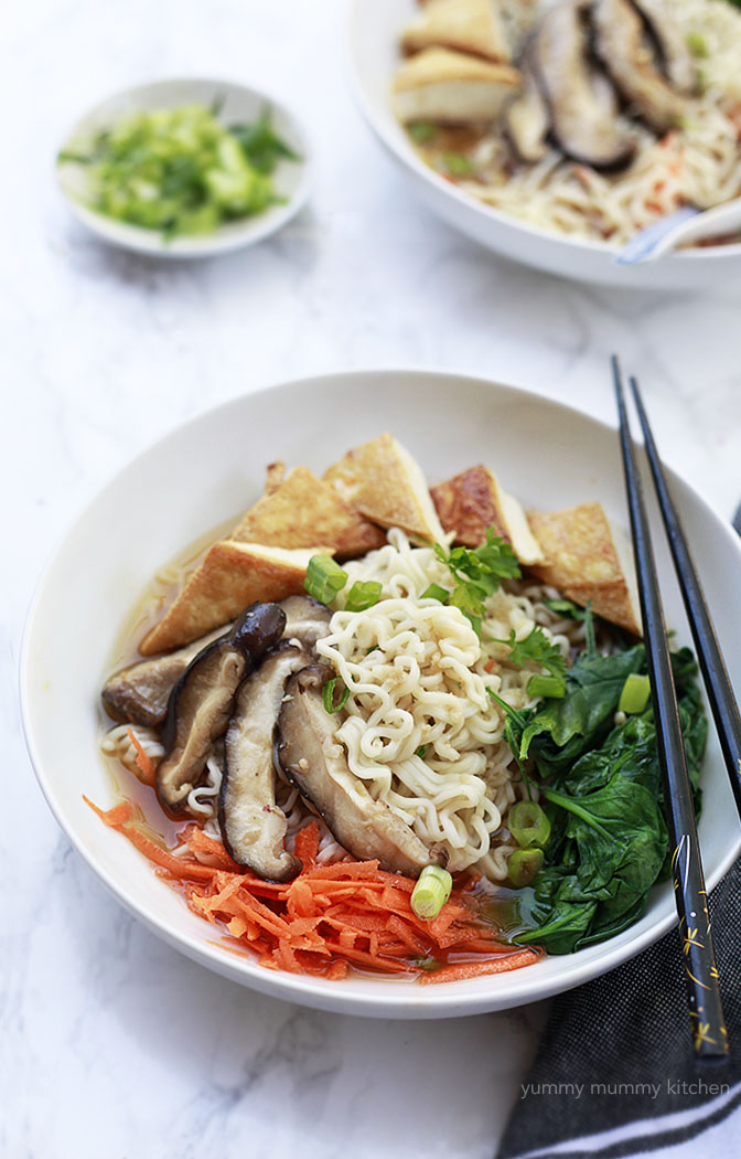 This quick and easy vegetarian and vegan ramen recipe is made with a homemade broth and topped with mushrooms, tofu, and spinach.
