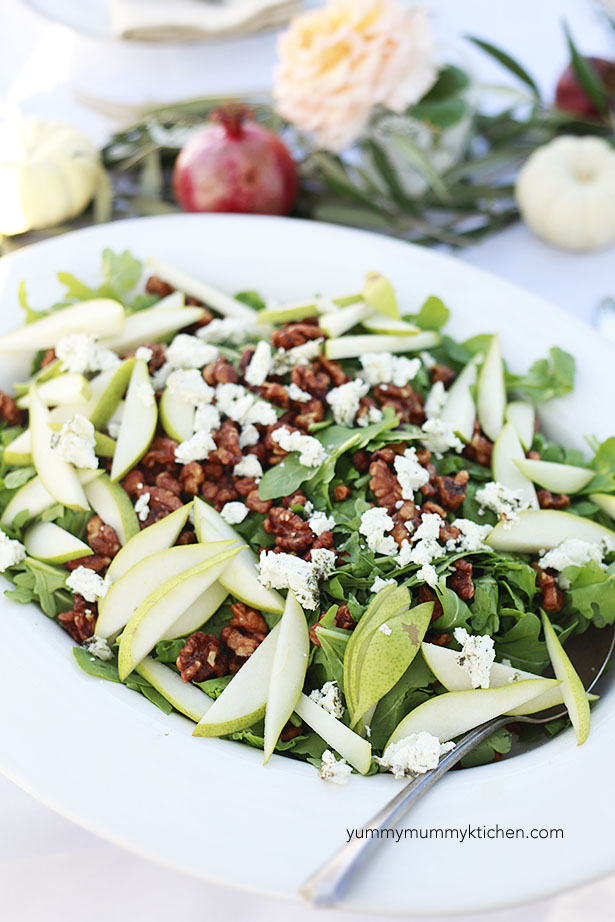 A beautiful autumn salad of arugula, pears, and candied walnuts is perfect for parties.