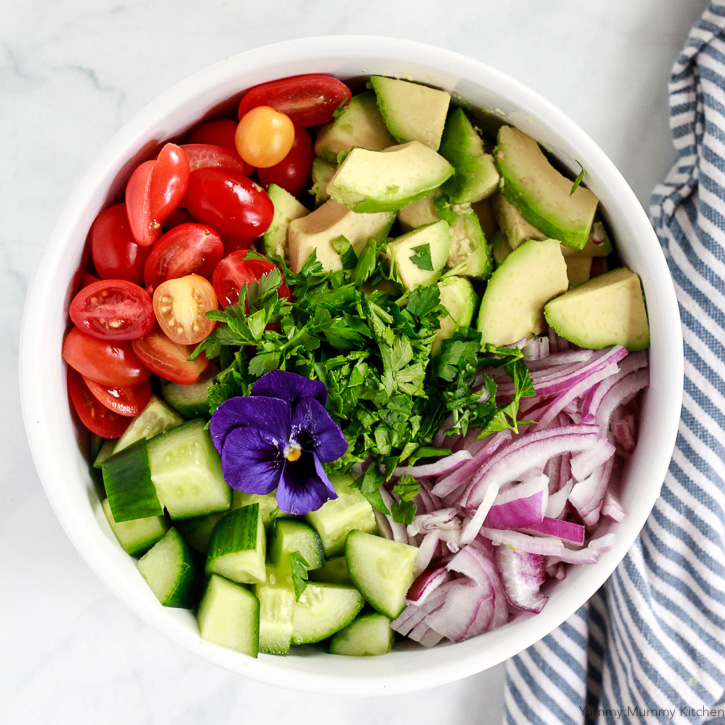 This avocado salad recipe is easy to make with just a few ingredients like cucumber, tomatoes, and avocado.