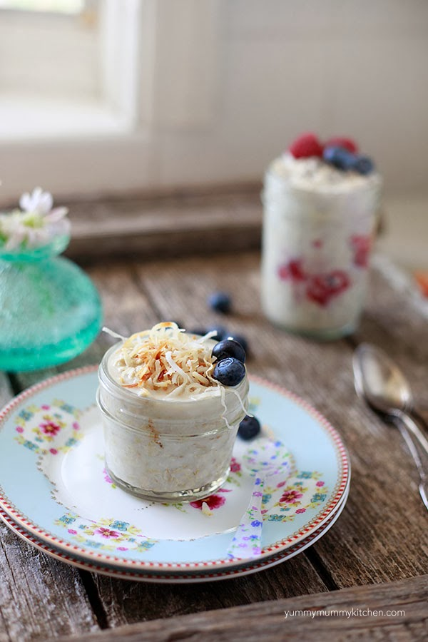 Overnight oatmeal jar made with almond milk and topped with coconut and blueberries.