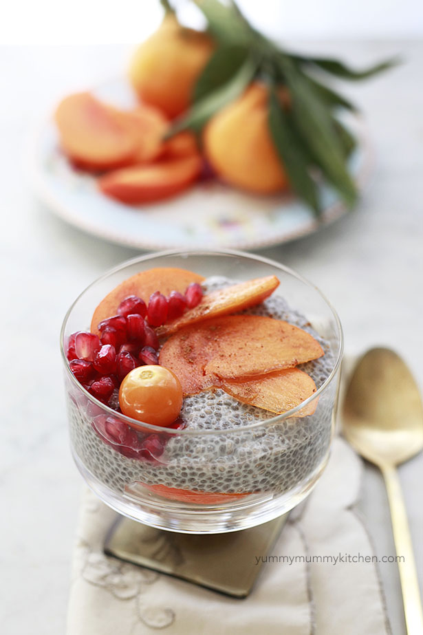 This basic chia pudding recipe is topped with persimmon and pomegranate seeds for an easy breakfast.