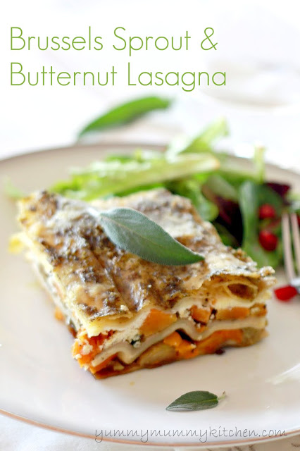 A slice of pesto Roasted Butternut Squash and Brussels sprouts lasagna with ricotta. A beautiful autumn vegetarian lasagna that would be perfect as a vegetarian Thanksgiving main dish.