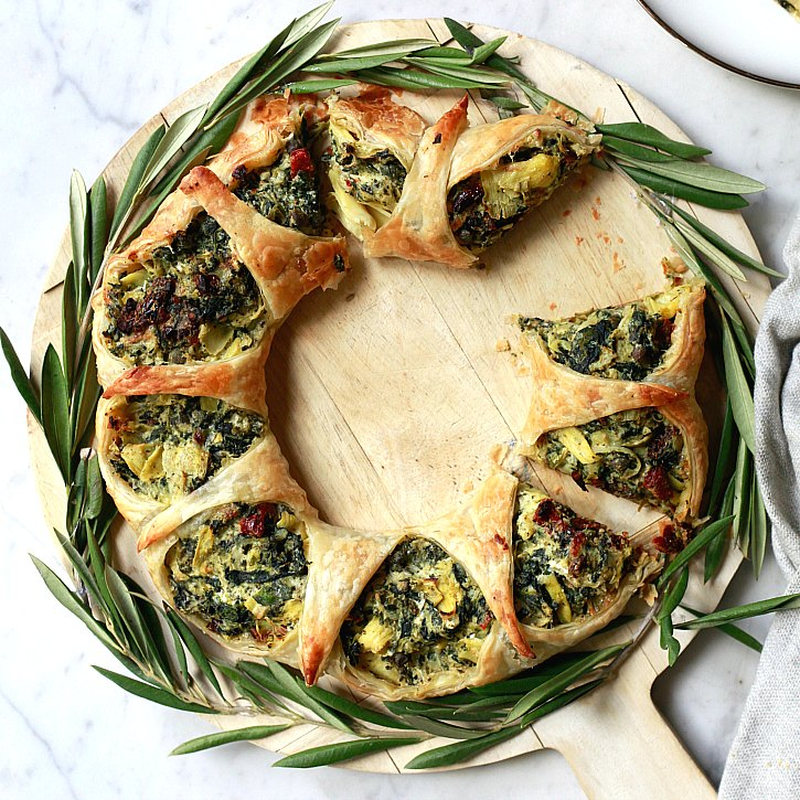 This beautiful puff pastry wreath filled with a hearty spinach artichoke mixture makes a lovely appetizer.