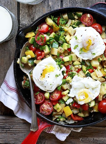 Veggie hash in a red skillet.