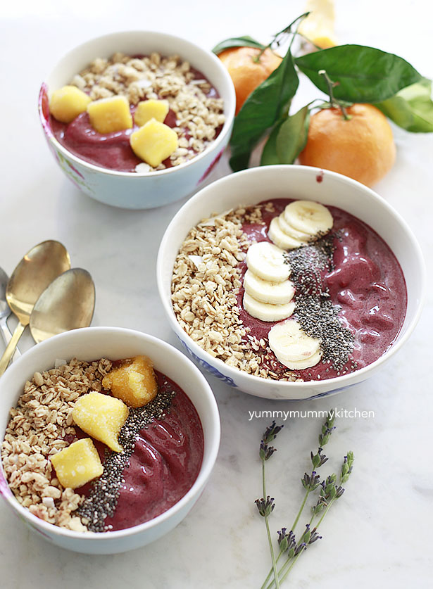 Three Acai superfood bowls topped with bananas, mango, and chia seeds.