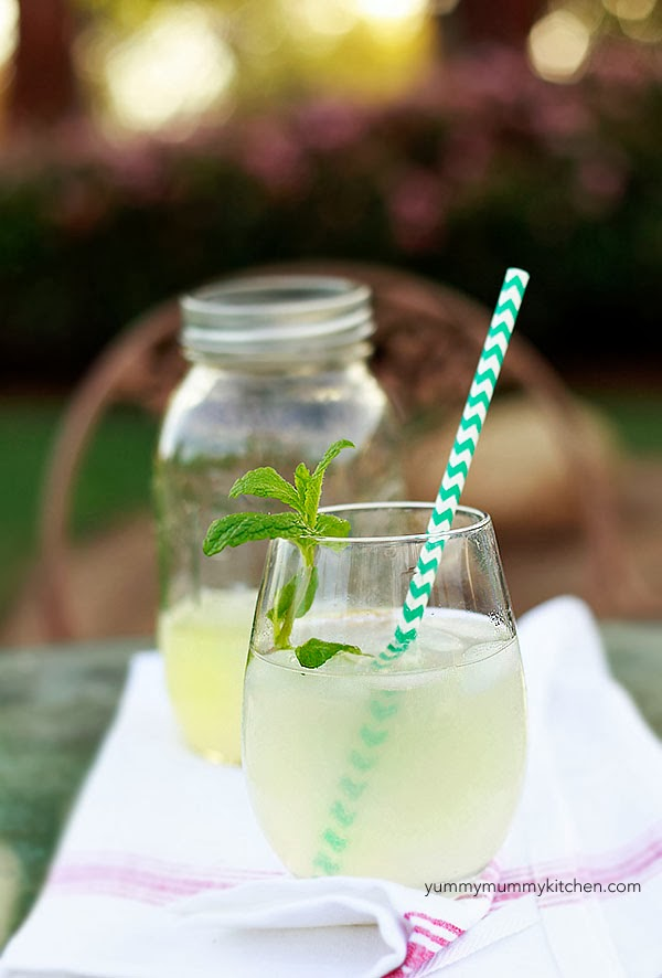 Homemade healthy sugar-free lemonade in a glass with a paper straw.