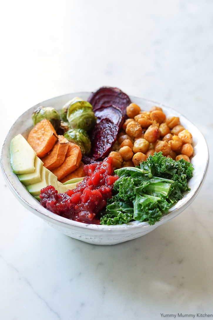 Curry roasted chickpeas and veggies make up a delicious autumn Buddha Bowl with cranberry chutney.