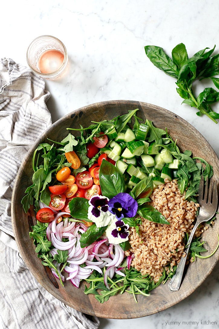 This beautiful Italian farrow salad recipe is made with healthy ingredients like arugula, tomatoes, onions, and cucumber.