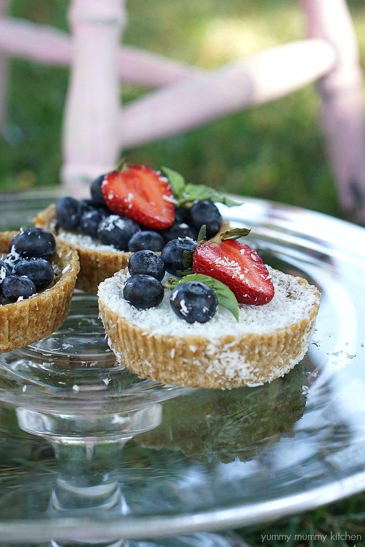 Vegan lemon and coconut tarts with berries