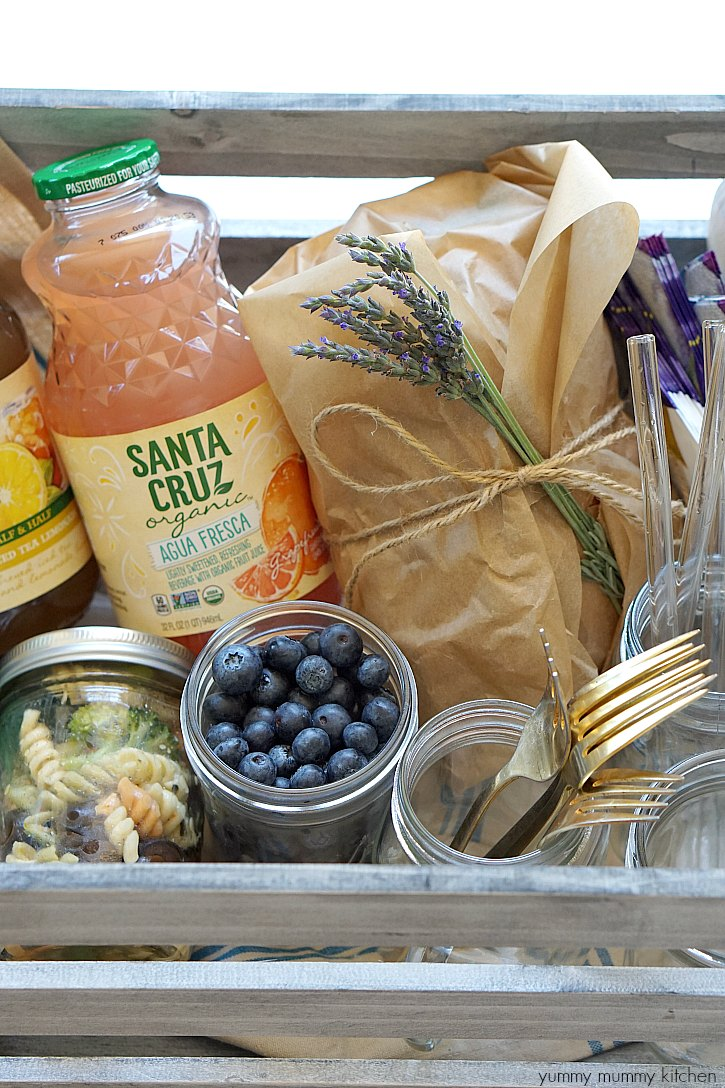 A picnic crate gets filled with pasta salad, berries, a vegetarian picnic sandwich, and Santa Cruz Organic lemonades.