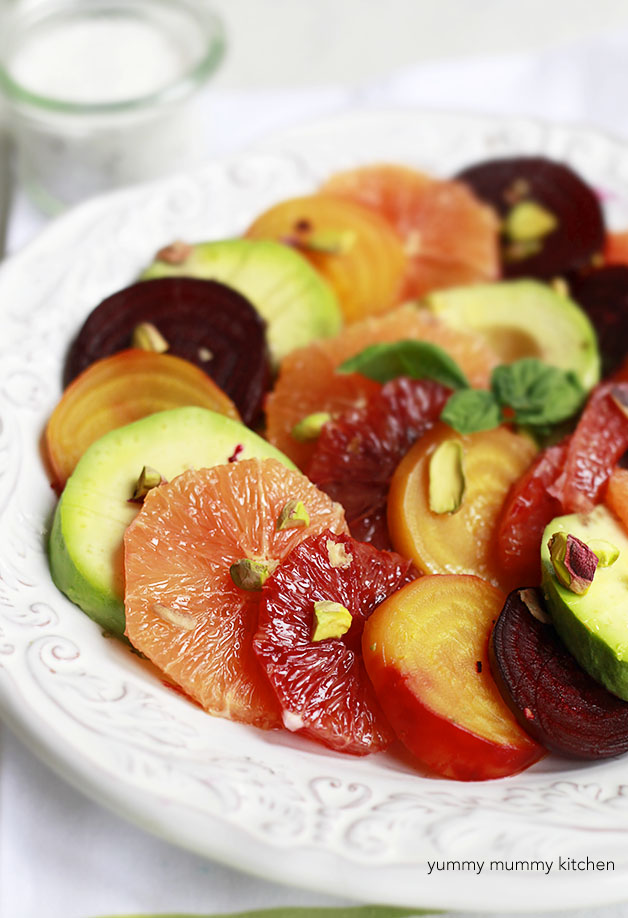 Beautiful citrus, beet, and avocado salad close up with pistachios.