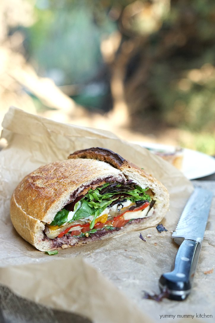 This vegetarian and vegan stuffed muffaletta sandwich is perfect for picnics.