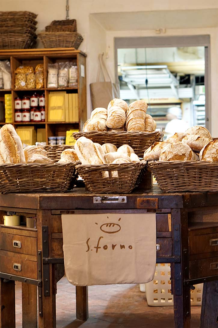 Beautiful fresh bread in baskets in S. Forno bakery