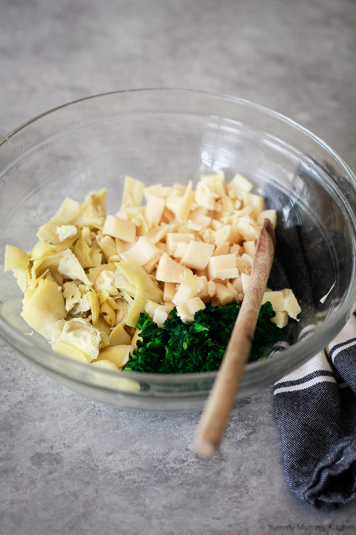 Ingredients for vegan spinach artichoke dip include artichokes, spinach, and hearts of palm.