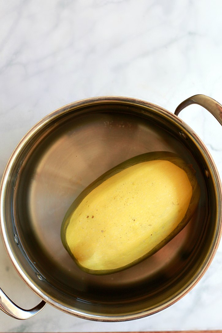 Find out the easiest ways to cook spaghetti squash. Boil whole spaghetti squash on the stove for an easy dinner.