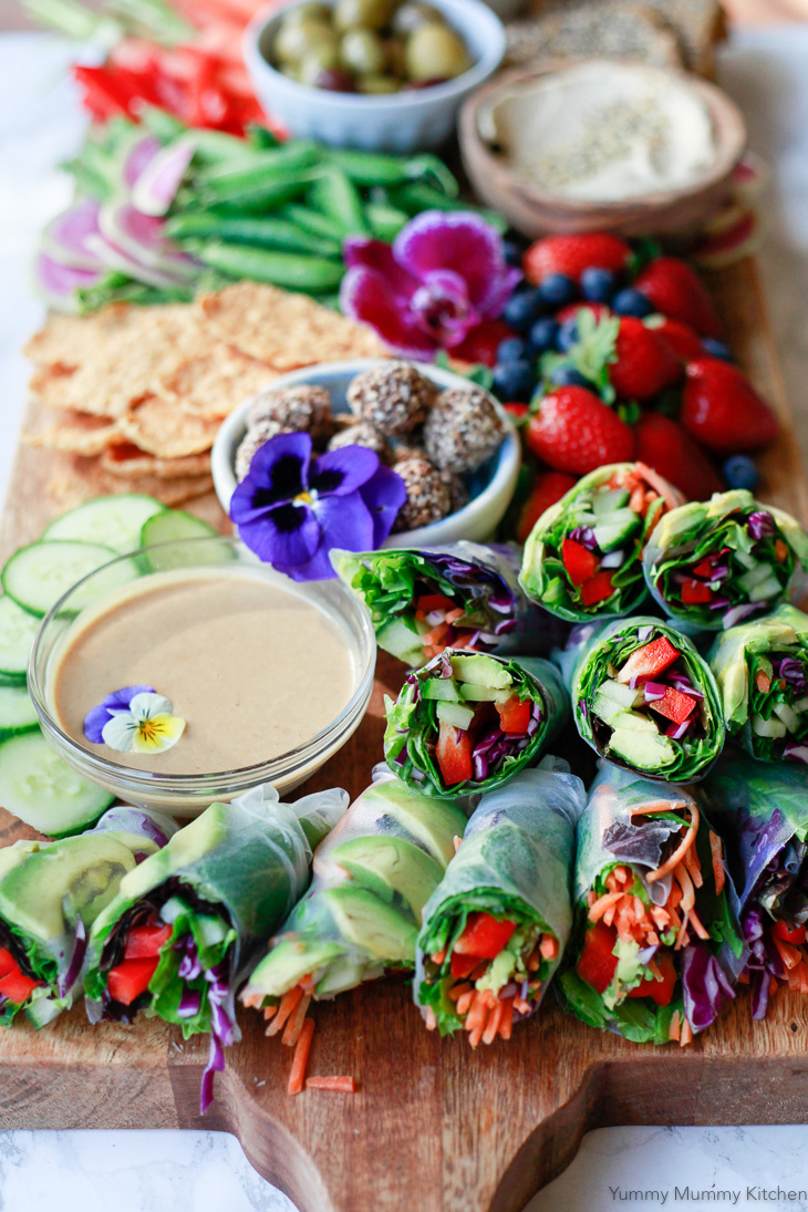 Fresh vegetarian and vegan spring rolls made with rice paper, avocado, bell pepper, and other veggies. Served with homemade peanut sauce, this spring roll recipe is so delicious.