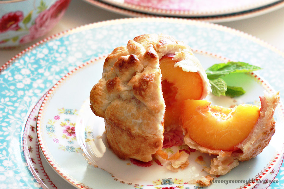 Individual Whole Peach Pie on a plate