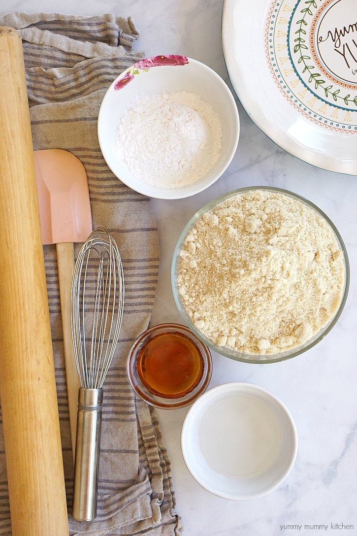 This gluten free vegan pie crust is made with almond flour, maple syrup, arrowroot, and coconut oil.