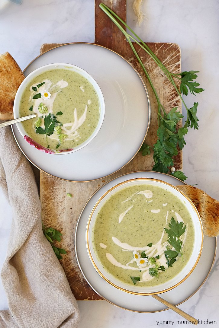 Beautiful bowls of creamy vegan broccoli soup topped with cashew cream.
